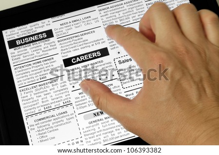 Fake Classified Ad, newspaper and Touch Screen, business concept.