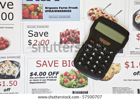 Fake coupon background with Calculator.  All coupons were created by the photographer.  Images in the coupons are the photographers work and are included in the release.