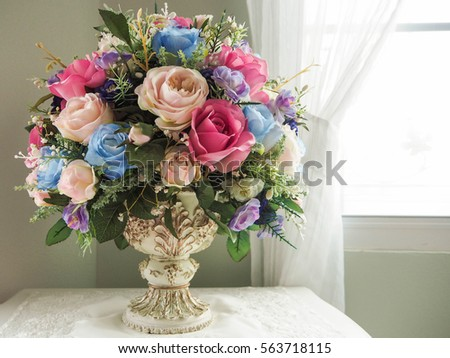 Fake flowers in a vase on the table