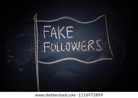 Fake followers flag, chalk drawing on blackboard. Fake social media popularity