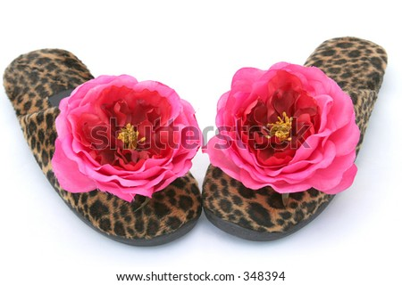 Fake fur bedroom slippers with plastic flowers. Isolated.