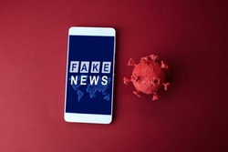 Fake news coronavirus on red background . Fake news Mobile concept.