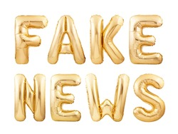 Fake news message made of golden helium balloons isolated on white background. Disinformation or yellow journalism concept