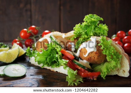 Falafel and fresh vegetables in pita bread