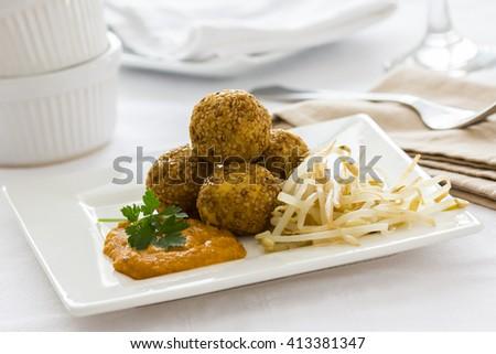 Falafel balls covered with sesame