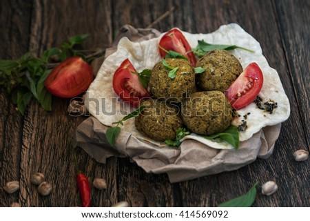 Falafel on pita on wooden table
