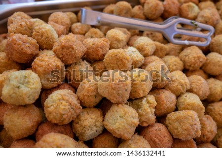 Falafel (or felafel) a deep-fried ball made from ground chickpeas or fava beans sold at local market