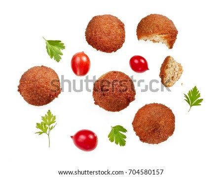 Falafels with cherry tomatoes and parsley leafs, top view