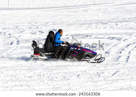FALAKRO, GREECE - FEBRUARY 11, 2013: Visitors enjoy the snow on snowmobiles in Falakro ski center, Greece. The ski resort of Falakro Mountain is located in the area of Dramas.
