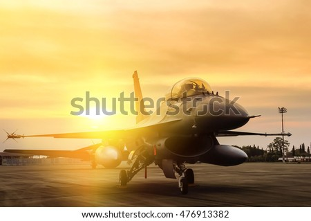 falcon fighter jet military parked on runway in airforce base on sunset time
