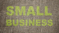 Falimy Business words printed on burlap canvas. Small business startup concept.