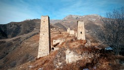 Falkhan village with the ruins of ancient battle towers and crypts. Russia, Republic of Ingushetia, Dzheyrakhsky region.