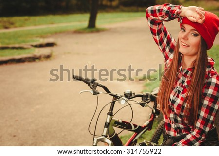 Fall active lifestyle concept,. Beauty young woman sporty casual girl relaxing in autumnal park with bicycle, outdoor