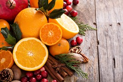 Fall and winter ingredients still life with oranges, cranberry, nuts and spices