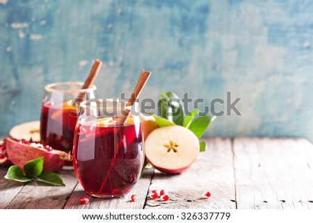 Fall and winter sangria with apples, oranges, pomegranate and cinnamon - Shutterstock ID 326337779