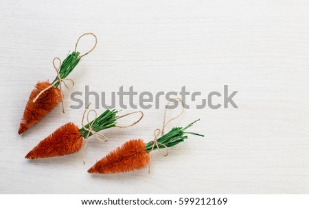 Fall autumn harvest spring easter orange carrots lying on white wooden table background with space for titles text #599212169