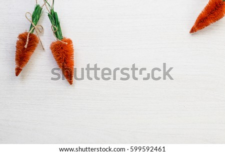 Fall autumn harvest spring easter orange carrots lying on white wooden table background with space for titles text #599592461