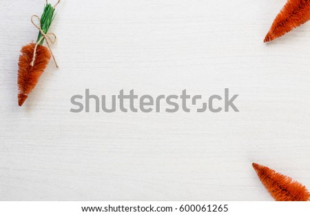 Fall autumn harvest spring easter orange carrots lying on white wooden table background with space for titles text #600061265