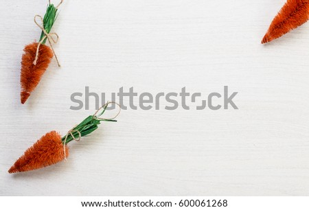 Fall autumn harvest spring easter orange carrots lying on white wooden table background with space for titles text #600061268