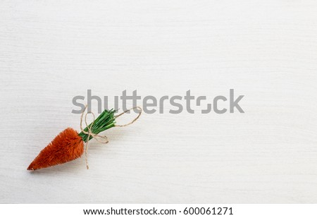 Fall autumn harvest spring easter orange carrots lying on white wooden table background with space for titles text #600061271
