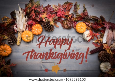 Fall, autumn pumpkins, leaves and veggies on a wooden background. Thanksgiving theme. - Shutterstock ID 1092295103