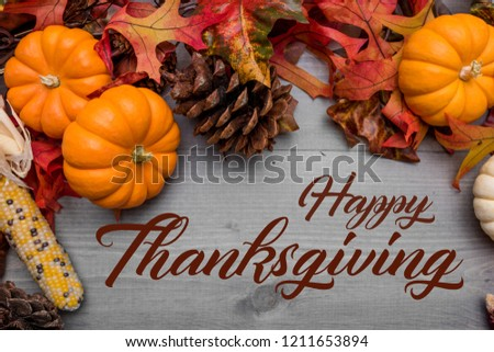 Fall, autumn pumpkins, leaves and veggies on a wooden background. Thanksgiving theme. - Shutterstock ID 1211653894