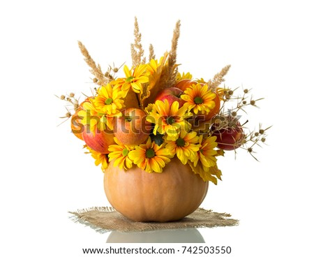 Fall bouquet in pumpkin isolated on a white background #742503550