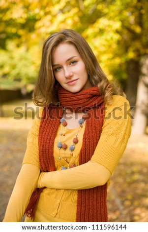 Fall color harmony, fashionable gorgeous young blond outdoors in the park.