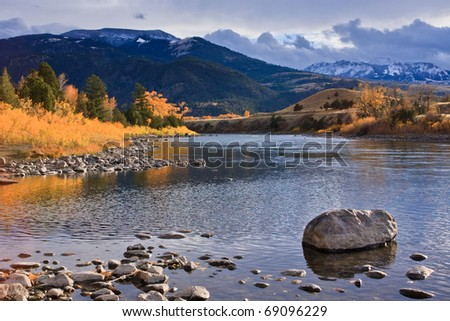 Fall foliage at its brightest along the Gardiner River, Montana.