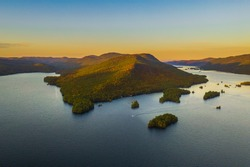 Fall foliage by Lake George at sunset. Photos are taken by drone.