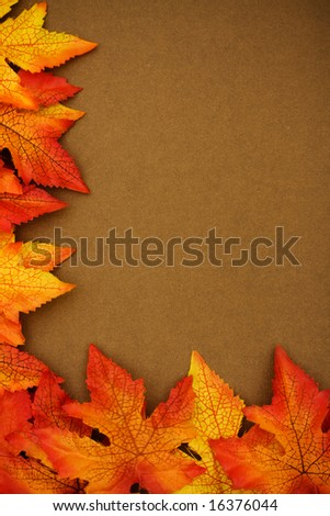 Fall leaves on brown background, fall border