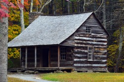 Fall log cabin in the woods
