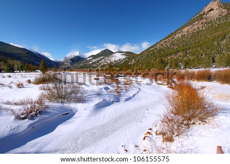 Fall River frozen over on a winter day in Rocky Mountain National Park of Colorado