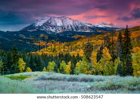 Fall rushes in to Colorado in the form of snow and frost at sunrise along Kebler Pass in Crested Butte as East Beckwith Mountain is covered in a fresh dusting. Сток-фото ©