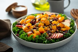Fall salad with kale, roasted squash, pumpkin seeds and apples