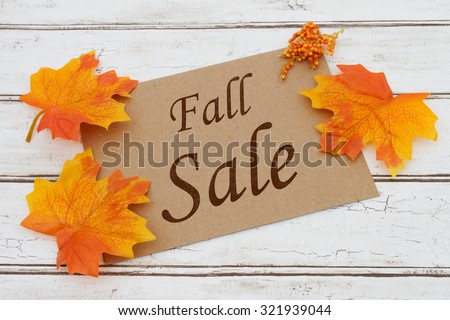 Fall Sale Card, A brown card with words Fall Sale over a distressed wood background with Autumn Leaves