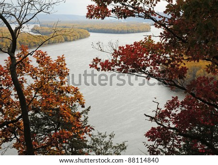 Fall scene: oak trees frame Mississippi River on a hazy day, viewed from Effigy Mounds National Monument, Iowa