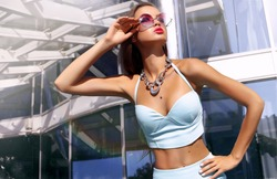 fall summer street fashion girl,having fun outdoor,wear stylish round sunglasses,accessories,Amazing glamour blonde woman in trendy summer outfit posing outdoor palm trees background. Bright make up