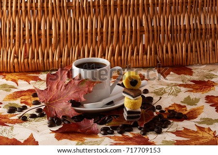 Fall time  coffee cup with coffee  coffee beans  sweets and leaves