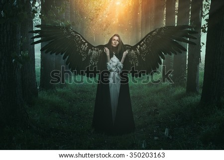 Stock Photo Fallen angel with sad expression and eyes to the sky