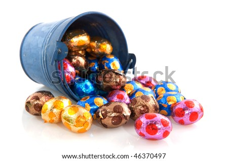 Fallen blue bucket with many easter eggs