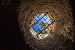 Fallen, deep down in a stone Well, looking up towards a blue sky
