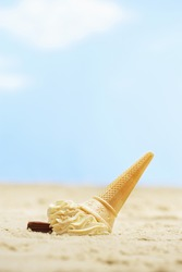 Fallen icecream in sand