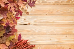 fallen leaves on wooden background, top view