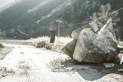 fallen rocks on the road