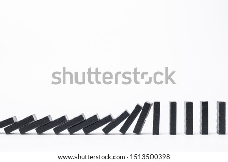 Falling black dominoes. Domino effect. Structural instability