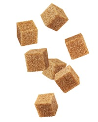 Falling Brown cane sugar cubes isolated on white background, clipping path, full depth of field