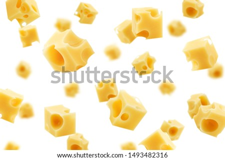 Falling cheese cube, isolated on white background, selective focus
