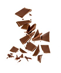 Falling Chocolate pieces and  shavings  isolated on white background