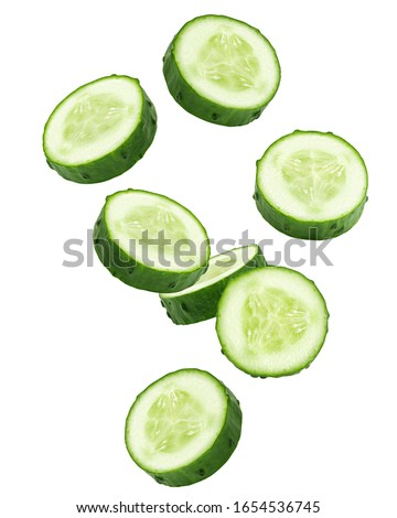 Falling cucumber slice isolated on white background, clipping path, full depth of field